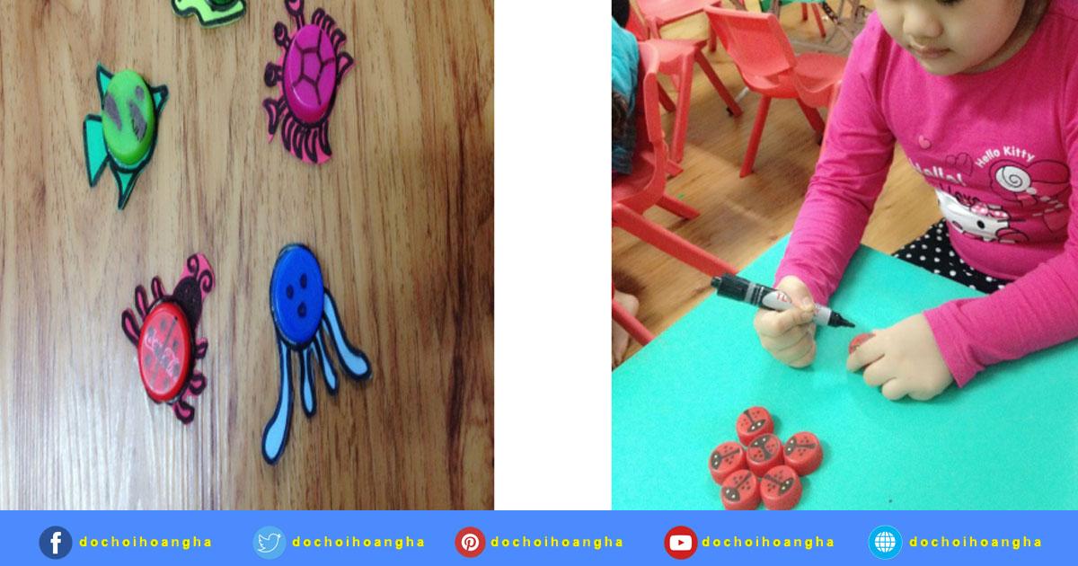 Những con vật nhỏ xinh đươc làm từ nắp chai: con cá,con bọ rùa, con cua, con ốc sên